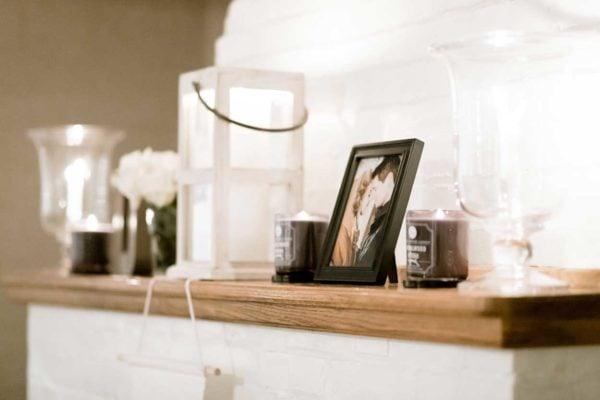 framed photograph on fireplace mantal